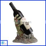 Novelty Halloween style decorative resin bloody zombie hand holding a bottle wine rack