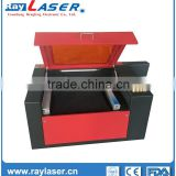manufacturing professional low cost plastic best service co2 laser engraving cutting machine price