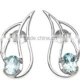 0.65ctw Genuine Blue Topaz Oval .925 Sterling Silver Stud Earrings