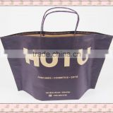 Creative style brown kraft paper bags flexo printing for hair accessories with patch handles