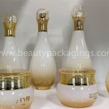 Antique Essence Pump Bottle And Face Cream Jar With Gold Plating Lid