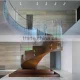 indoor stainless steel standoffs frameless glass balustrades with curved wood staircase