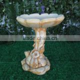 Antique fiberglass bird feeder with lotus flower design