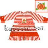 Beautiful hand smocked dresses for Halloween with pumpkin smocked pattern