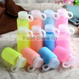 Factory low price of unbreakable silicate glass water bottle,anti heating slicone sleeve glass water bottle