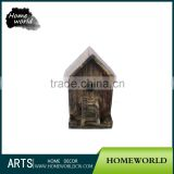 Hand carved birdhouse-shaped wooden folk craft
