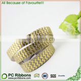 "stock item of 5/8"" chervon gold foil printed elastic ribbon"