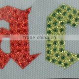 Heat transfer glitter vinyl patterns with hot fix rhinestones and rhinestuds for garments