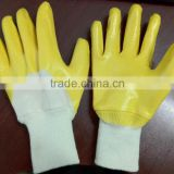 light weight 3/4 dipped orange nitrile glove Abrasion resistant knitted wrist to exclude debris open back improves ventilation.