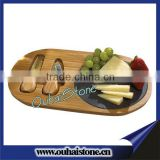 Oval wood chopping board with round slate cheese serving set and knife