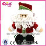 stuffed child toy of Santa Claus