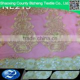 New arrival african pink applique tulle wedding dress lace fabric with cord lace border                                                                                                         Supplier's Choice
