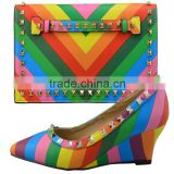 Fashion shoes women high heel wedge shoes rainbow color and matching clutch bag shoes.