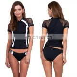 Rash guard manufacturer custom black and white short sleeve zip up panelling mesh surf lycra rash guard for ladies
