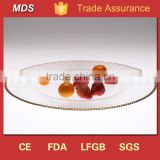 Glass charger heated bulk dinner plate with gold rim