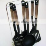 Passing SGS senior 7-pieces black nylon kitchen utensil set with stainless steel hollow handle and metal stand 001A