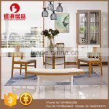 Modern wooden high glossy white and teak color round functional dining table and dining chair in dining room sets