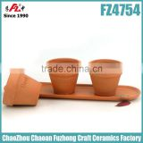 Small and round terracotta planter with saucer