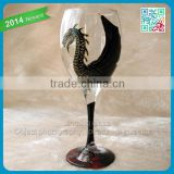 Striking handpainted black dragon wine glass finished in gold outliner decorate red wine glass