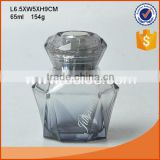 Fancy diamond shape perfume bottle with nozzle and cap