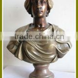 bronze woman statue on the table
