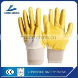 Best selling cotton liner with yellow nitrile coated anti oil safety working glove for industry