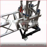 Aluminum truss sleeve block with wheel for lifting system