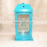 blue metal lantern with clear glass wall