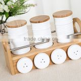 Eco-friendly bamboo racks wholesale ceramic spice canister,ceramic spice canister set,ceramic spice canister with bamboo lid