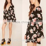 A woven floral print skater dress with long bell sleeves a plunging V-neckline side zipper