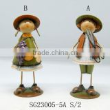 metal home decorative autumn boy and girl wearing hat with fruit and knife