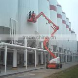 China cheap price 14m self-propelled articulating boom lift,trailer mounted boom lift