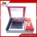 China Jinan DW-5030 lowest price mini co2 laser engraving and cutting machine on wood plastic crystal