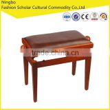 2015 Brown adjustable piano bench with leather stool surface