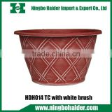 garden outdoor terracotta colored plastic flower pots