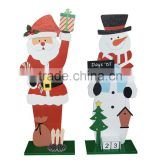 Wooden christmas decoration at home snowman/santa claus deco in family with advent calendar block