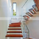 floating stairs with frameless glass balustrade and oak tread and stainless steel hadnrail