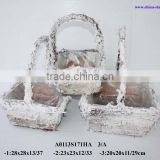handmade birch basket with falling snow