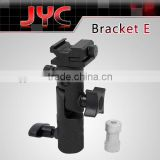 Camera mounting bracket fits light stand or 1/4'' or 3/8'' tripod directly