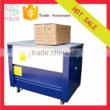 Table type semi automatic electric carton box tying machine