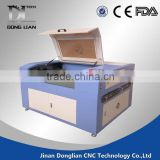cheap beautiful design jinan Donglian laser cutting and engraving machine price for coconut shell