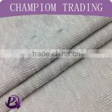 China hot sale fashion design elastic polyester star foil hacci knitted fabric for cloths