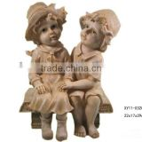 Resin boy and girl figurines