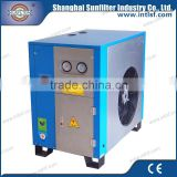 Refrigerated air dryer export with compressor cooler and pneumatic cylinders for air compressor head
