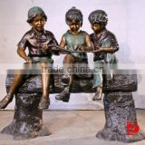Garden bronze children sculptures Sitting and palyiny a butterfly