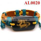 beautiful shiny colored handmade leather bracelet with an ox bone carved dragon patterns AL0020