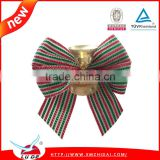 Gift packing use gold metallic ribbon bows with bell