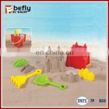 Red plastic sand castle buckets with spade