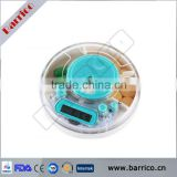 Whole sale PP 7 compartments electronic alarm reminder round pill box