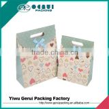 Wholesale high quality with satin bow diecutting paper gift bag with flap